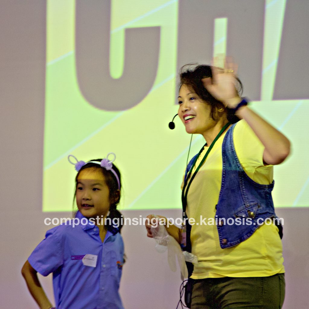 Workshop instructor, Sarah, greeting the girl's parents onstage