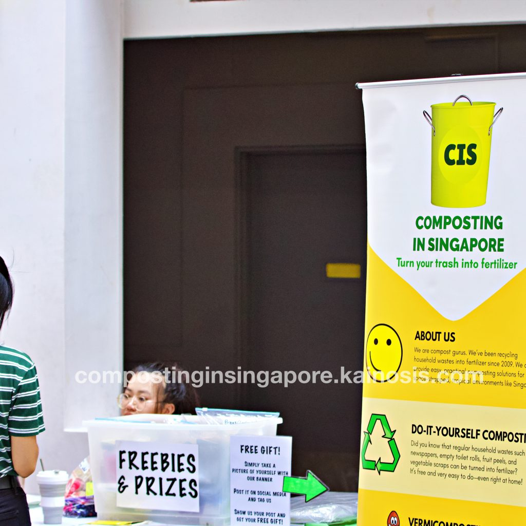 CIS' bright yellow banner on composting gives a good photo opportunity!
