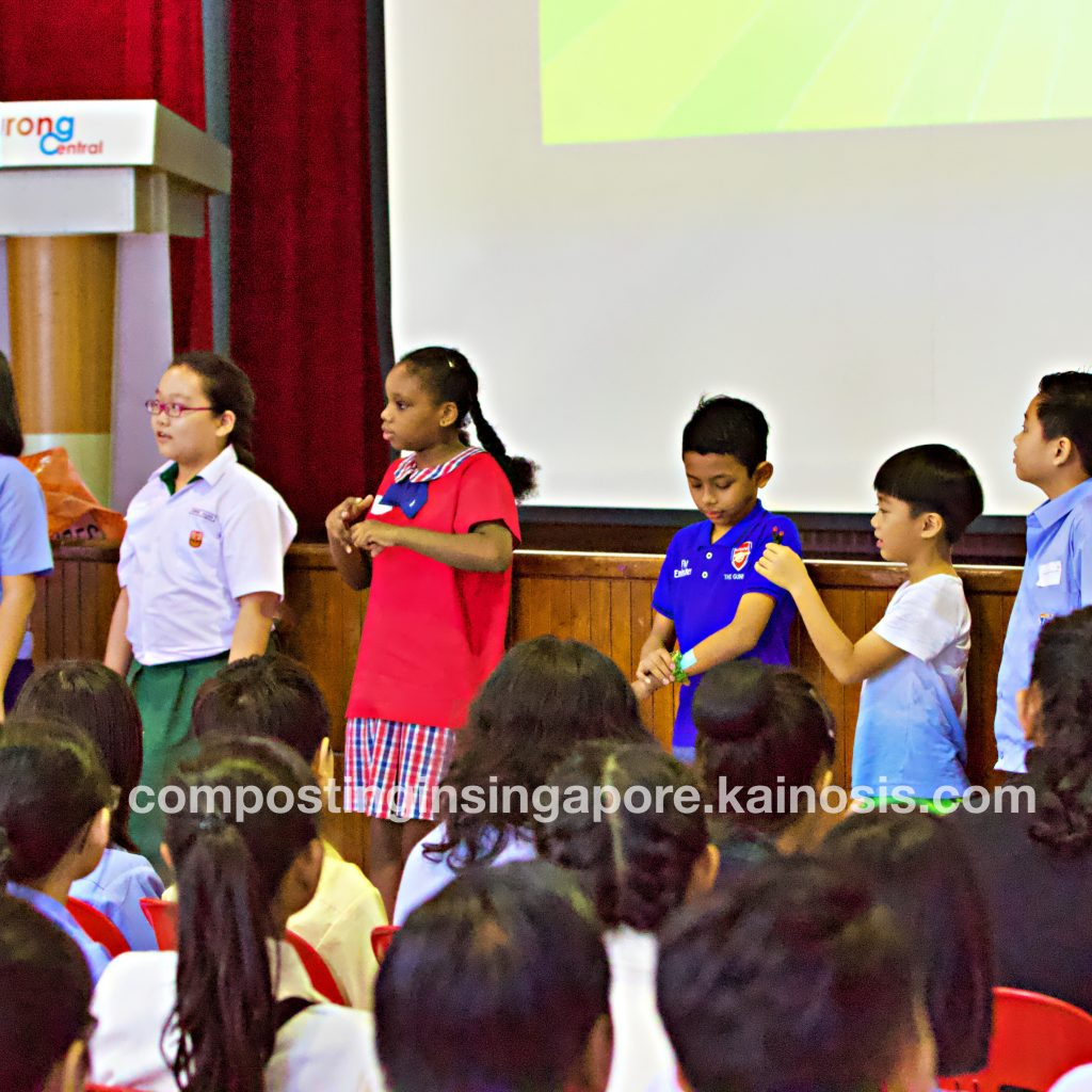 Kids participating in an activity during the composting workshop