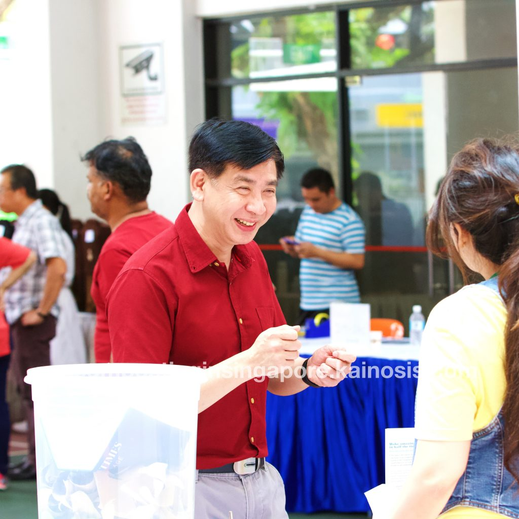 Mr Ang Wei Neng, member of parliament for Jurong GRC, enjoying conversation and asking questions at our compost booth