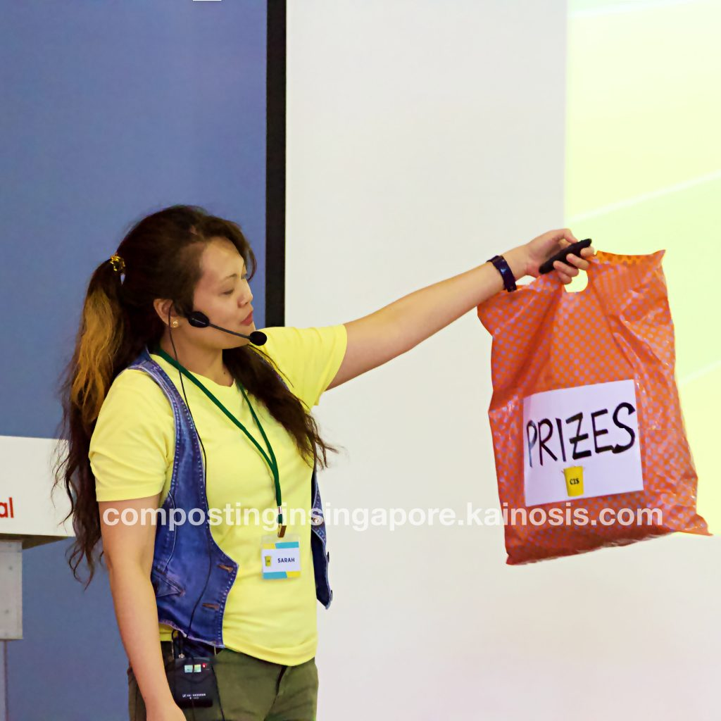 Workshop instructor, Sarah, showing a bag of prizes to be given out during the session