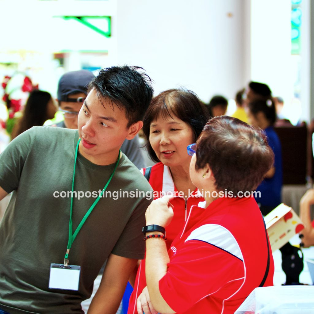 Booth facilitator (left) giving helpful directions to participants