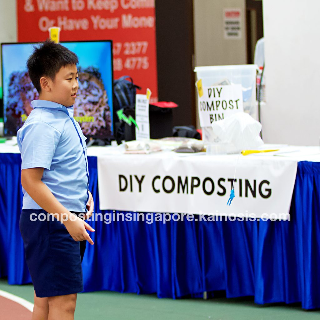 Student having fun with a freebie from our compost booth - can you spot it floating in mid air?